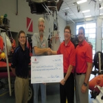 Representatives from the Charles County dive and rescue company accepts a donation from Community Bank of the Chesapeake.